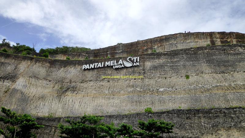 The Melasti Beach Name On High Cliff