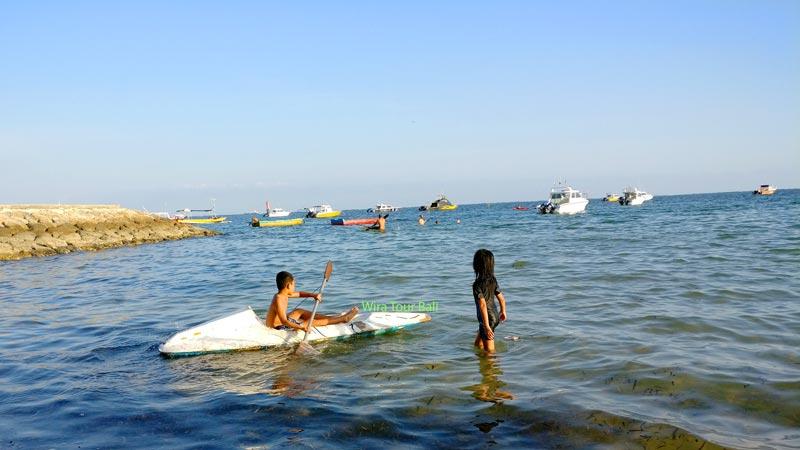 Canoeing With Children At Semawang Beach